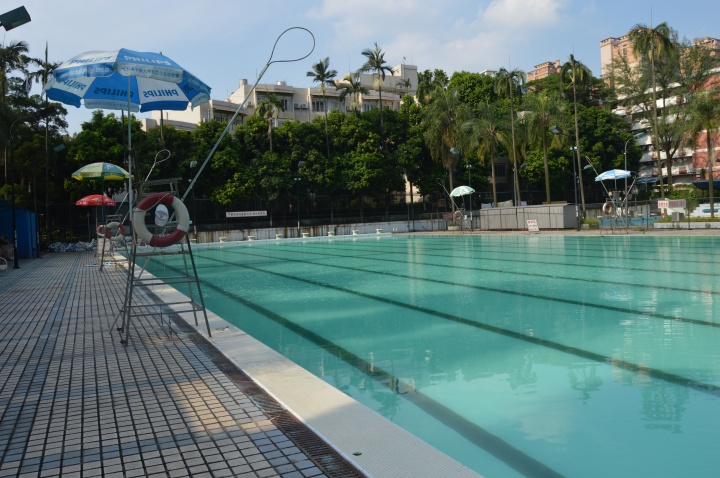 Chinese water torture: the pool I haven't been allowed to use, with my building in the background.